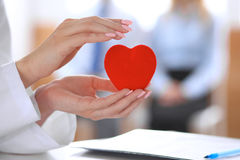 Free Female Doctor With Stethoscope Holding Heart. Royalty Free Stock Photos - 94569328