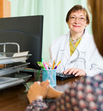 Female  doctor and woman discuss something Royalty Free Stock Photo