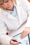 Female doctor at work Royalty Free Stock Image