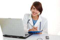 Female doctor at work use laptop Royalty Free Stock Images