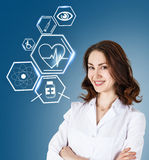 Female doctor working with healthcare icons Royalty Free Stock Photos