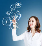 Female doctor working with healthcare icons Stock Photo