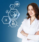 Female doctor working with healthcare icons Royalty Free Stock Photography