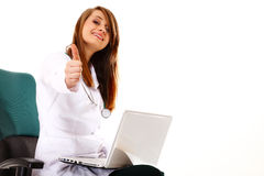 Female doctor working on her laptop isolated Stock Image