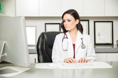 Female doctor working in her office Stock Photography