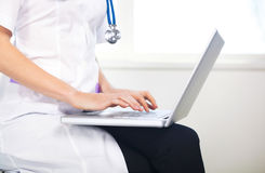 Female doctor working with laptop Stock Photos