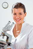 Female doctor working with a microscope Stock Image