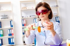 The female doctor working on new teeth implant stock photography