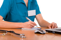 Female doctor working in office Royalty Free Stock Image