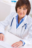 Female doctor working at office Stock Photos