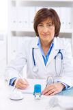 Female doctor working at office Stock Image