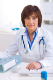 Female doctor working at office Stock Images