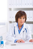 Female doctor working at office Royalty Free Stock Photos
