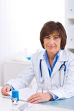 Female doctor working at office Royalty Free Stock Photography