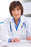 Female doctor working at office Royalty Free Stock Photo