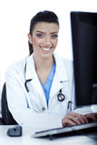 Female doctor working in the system Royalty Free Stock Photos