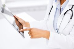 Female doctor working with tablet pc. Medicine, health and hospital concept - close up of female doctor working with tablet pc Stock Image