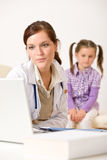 Female doctor write prescription for child Royalty Free Stock Photography