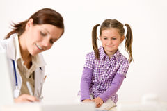Female doctor write prescription for child Stock Images