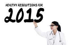 Female doctor writes health resolution Royalty Free Stock Photo