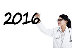Female doctor writes numbers 2016 Stock Image