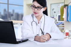 Female doctor writes a prescription Stock Photography
