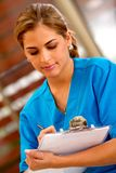 Female doctor writing Royalty Free Stock Images