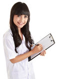 Female doctor writing on binder clip Stock Photography