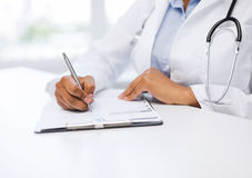 Female doctor writing prescription Royalty Free Stock Photo
