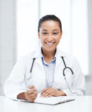 Female doctor writing prescription Royalty Free Stock Photography