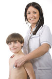 Female doctor and young boy Royalty Free Stock Photos