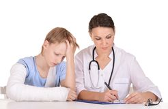 Female doctor and young boy Royalty Free Stock Images