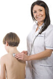 Female doctor and young boy patient Stock Photo