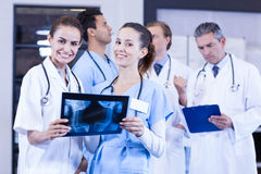 Female doctors checking x ray reports Stock Photos