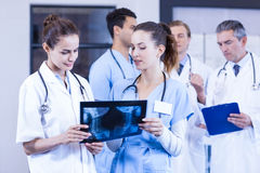 Female doctors checking x ray reports Royalty Free Stock Photo