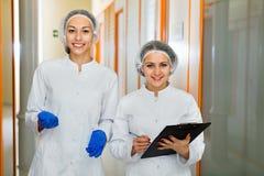 Female doctors discussing beauty procedures Stock Image
