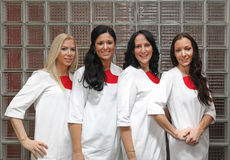 Female doctors. Four female doctors in wearing white uniforms Royalty Free Stock Photos