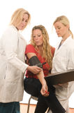 Female doctors nurses with patient Stock Photo