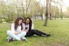 Female doctors student outdoors with phone. medical background . concept of education. students near hospital in flower garden. stock photos