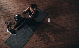 Female doing abdomen workout at the gym royalty free stock image