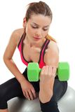 Female doing bicep curls Stock Photography