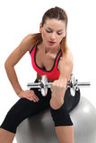 Female doing dumbbell curls Stock Photo