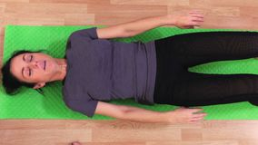 Female doing exercise for abs. In room stock video footage