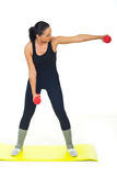 Female doing exercise with dumbbell Stock Photo