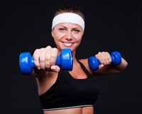 Female doing exercises with dumbbells Royalty Free Stock Photography