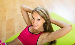 Female doing exercises at home Stock Image