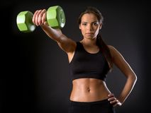 Female doing front shoulder fly Stock Image