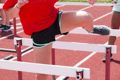 Female doing hurdle drills on the track Stock Photography