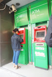 Female doing Kasikorn Bank automatic teller machine. Female doing at automatic teller machine, On top has close circuit television, At Kasikorn Bank ATM of Stock Image