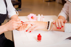 Female doing manicure Royalty Free Stock Photos